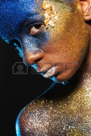 23701123-portrait-of-a-woman-who-is-posing-covered-with-blue-and-gold-paint